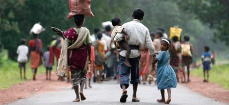 Christians return for shelter after spending days in hiding in forest at Naugram village