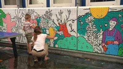 muurschildering AZC